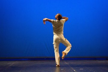 "Jurij Konjar performing Steve Paxton's ""Bound."" Photograph by Nada Zgank"