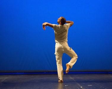 "Jurij Konjar performing Steve Paxton's ""Bound."" Photograph by Nada Zgank"