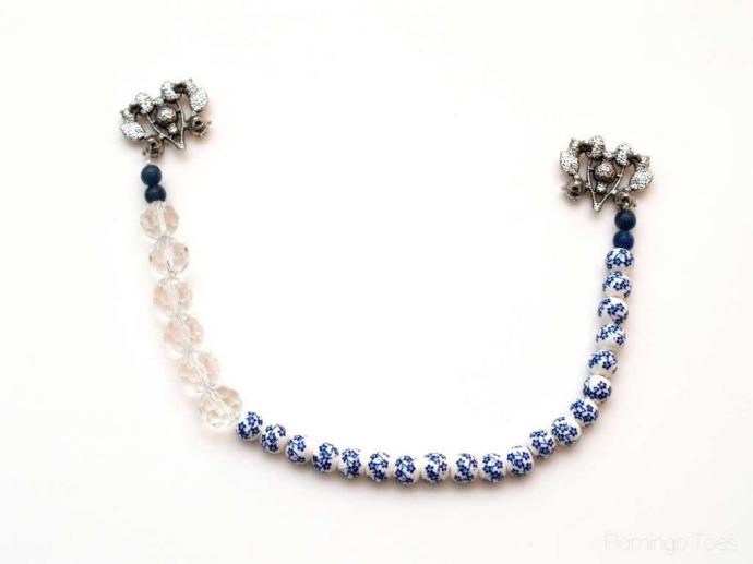 connecting necklace strand to brooch