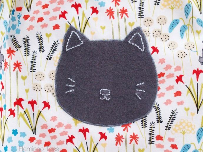 Kitten applique on skirt