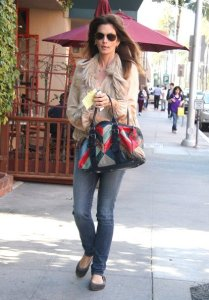 Cindy Crawford bundles up from the cool season with a suede pair.