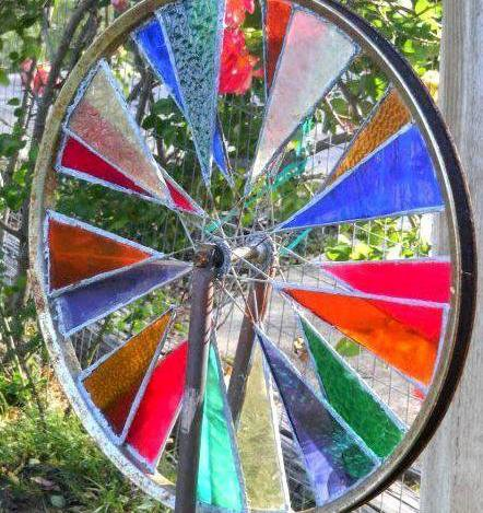 Stained glass bicycle wheel, close up.