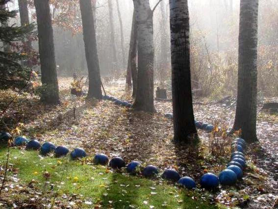 Bowling balls wind through the woods