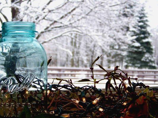 Shelly Paige's cool winter view, simply a Mason jar, a garland of lights set onto a windowsill
