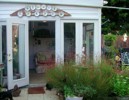 Becky Norris This is a photo taken today showing the hot pink Gaura blooming next to the door of my garden room. I love this area of the garden and spend a lot of time on this porch.