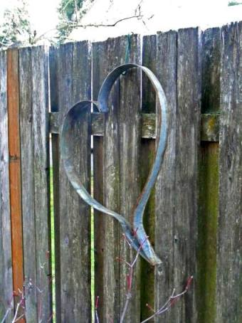 Patty Hicks's barrel hoop heart hung ion her fence. She says, This will eventually be hung on the flat side of one of our trellises out back. I saw a picture of them hung like that and they looked so cute.