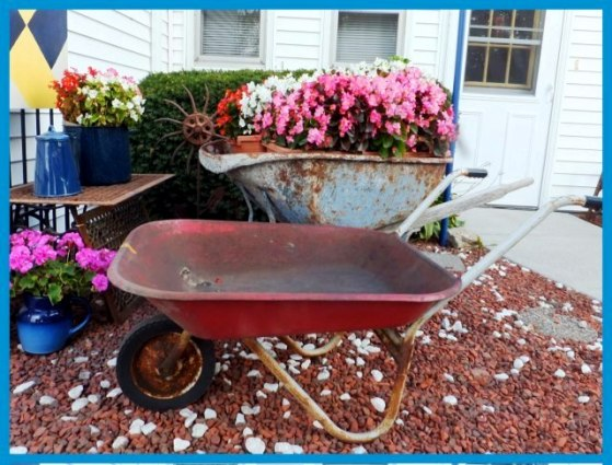 Nancy K. Meyer's red wheelbarrow has its own story. And see 'Big Blue' just behind