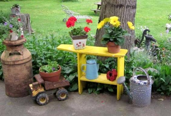 Gail Schuit pints a small shelf as an accent, contrasting the bright yellow with more rustic metal...and flowers!