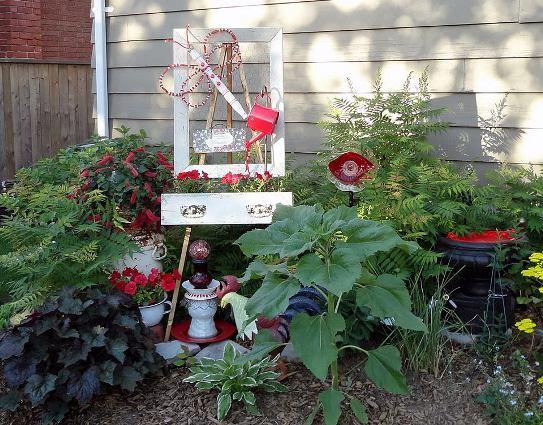 Linda Gladman's frame adds height to garden flower bed