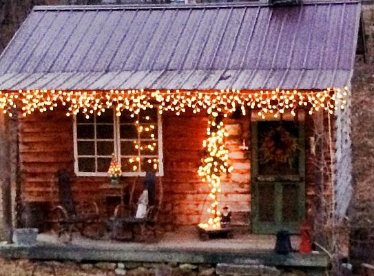 Vickie Glenn's glowing  little dream cabin in winter