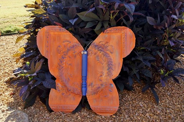 Repurposed Life cut a butterfly from a rusty square of tin ceiling tile