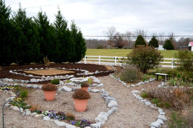 Laying out the garden.  The square plot at left became a sitting area under a tree