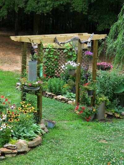 Dandi Gentry's arbor divides her garden rooms