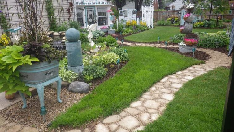 Ann Elias designed this winding path with a concrete form in mind