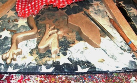 Frog tile starts out in pieces of cut out clay