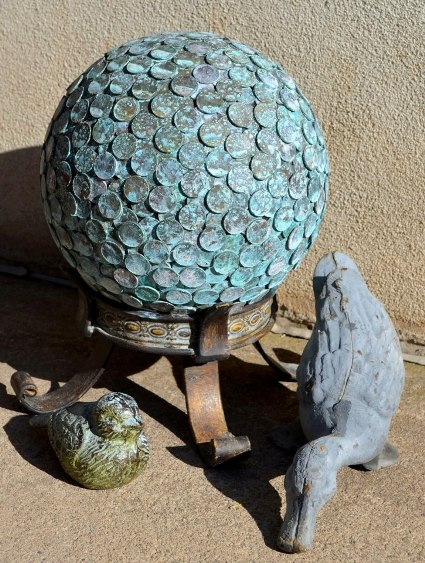Marie Niemann's penny ball, with a verdigris patina
