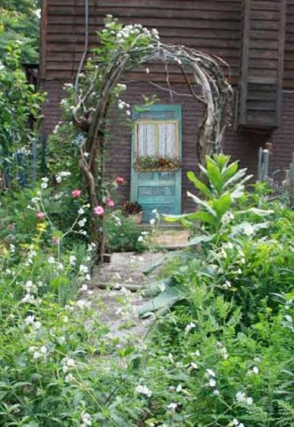 Stephie McCarthy's quaint blue door viewed through the twig arbor
