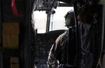 Captain Tye Mastertson Co Pilot for this sortie checks the troops in the back of the CH-47 Chinook are ready prior to takeoff in Kandahar Afghanistan