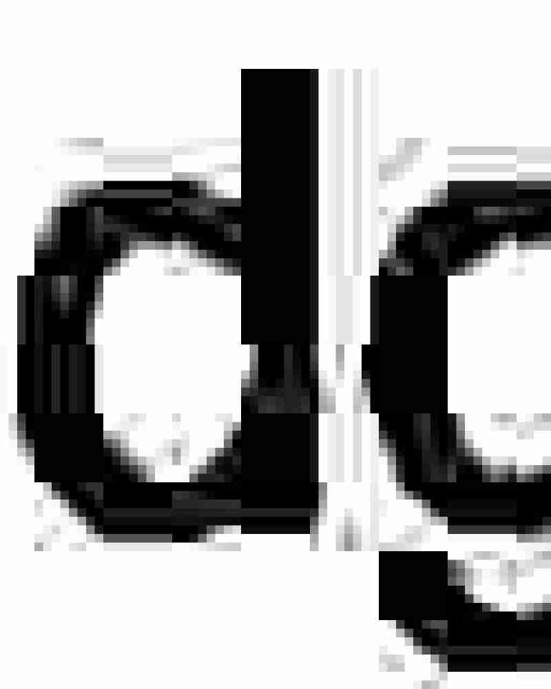 Fried eggs, fried tomatoes and edible flowers.