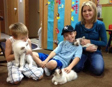 These are my grandsons and my daughter in law with my babies Moch and Mitz and their little ragdoll Bella. After I got mine, the got there's two weeks later, cuz as you see they were hooked