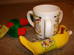 a YEOWWW! banana, a YEOWWW! Candy Cane and an Official Yeowww!® 3-Handled Mug