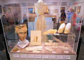 The wedding dress was worn by five members of the same local family. The wedding photos are displayed, too, at the Elliott Museum on Hutchinson Island near Stuart