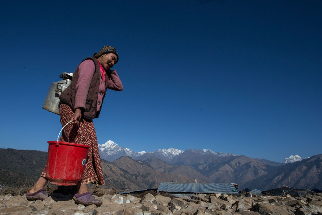 Woman in Gorkha district, Nepal, carrying drinking water. Photo: UNICEF/Narendra Shrestha