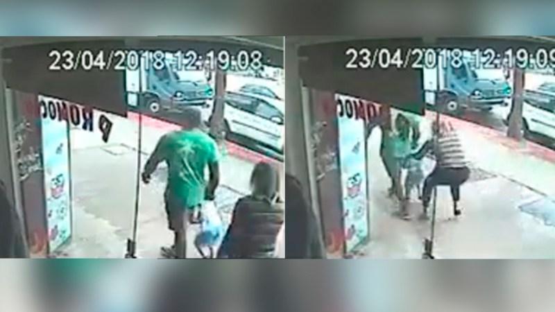 Imagem acima mostra o momento em que a mãe segue o homem e tenta tirar seu filho dele (Foto: Reprodução)