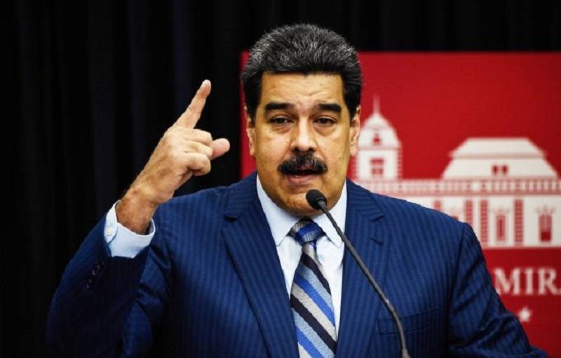 O presidente venezuelano Nicolás Maduro à imprensa: Brasil fará 'provocações militares na fronteira' e Colômbia fornecerá mercenários treinados - 12/12/2018 (Federico Parra/AFP)