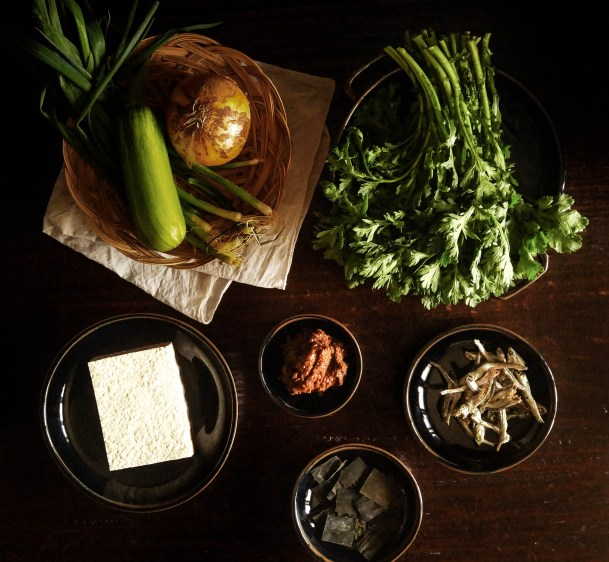 Ssukgat doenjang-guk: fermented soybean soup with crown daisy greens.