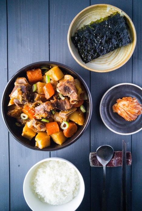 Galbi jjim: Korean soy sauce braised beef short ribs.