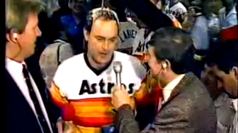 Nolan Ryan being showered with beer after a 1986 playoff victory.
