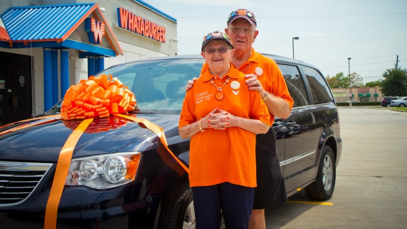 Karl and Carol Hoepfner pose with their new minivan after completing their tour of every Whataburger location.