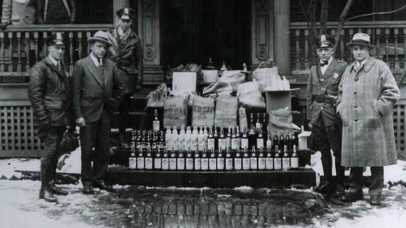 "During Prohibition, law enforcement would often crack down on illegal bars known as ""speakeasies."""