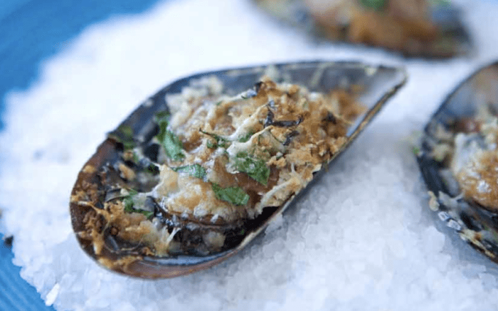 Usually done with oysters, this twist on a New Orleans classic is done on mussels. (Photo: Clare Barboza.)