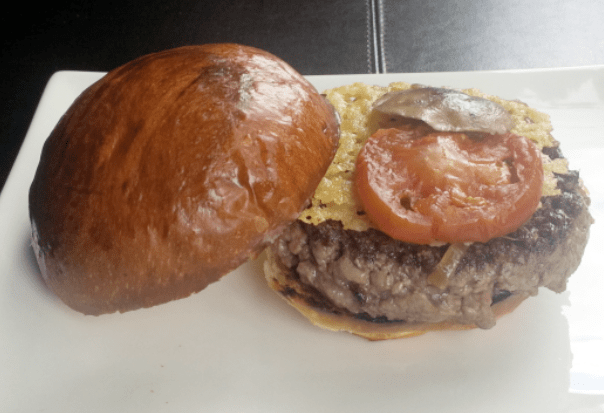 The Original Burger features a Parmesan crisp, shiitake mushroom, tomato and caramelized onions.
