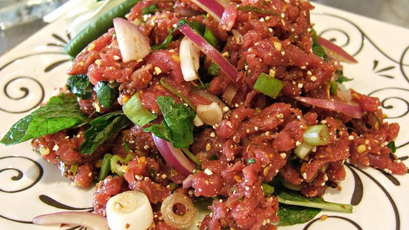Chili powder, onion, mint and lime juice give flavor to the Thai version of tartare, num tok koy.