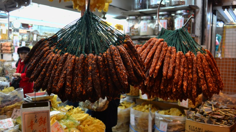 Chinese sausage can be found at any Cantonese butcher shop, hung from the ceiling. (Photo: logatfer/Flickr.)