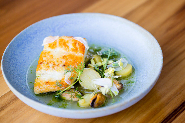 Local halibut, mussels, garlic and lemongrass braissage at Lord Stanley. (Photo: Antoinette Bruno.)
