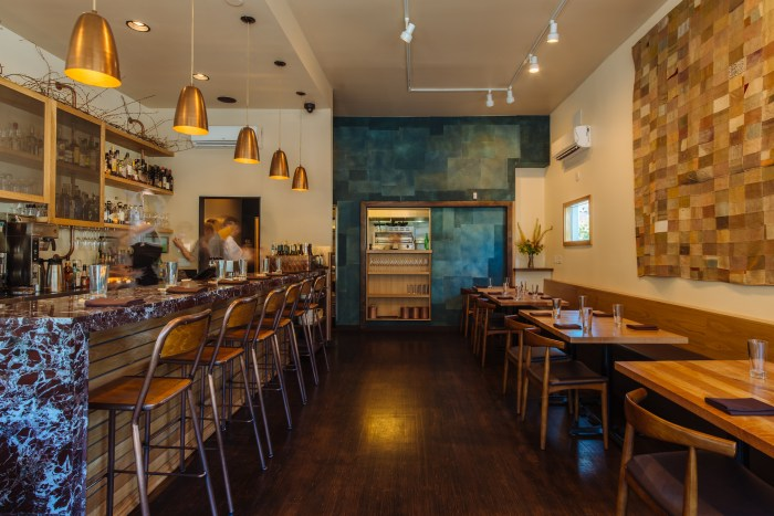Coquine seamlessly transitions from a casual breakfast and lunch nook to bustling neighborhood restaurant come evenings. (Photo credit: Joshua Chang)