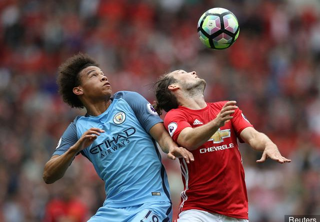 manchester_citys_leroy_sane_in_action_with_manchester_uniteds_da_305960