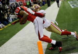 On the touchdown by Falcons receiver Julio Jones, side judge Gary Cavaletto and back judge Tony Steratore quickly confirm with each other on a very tight touchdown call. (Jimmy Cribb/Atlanta Falcons)