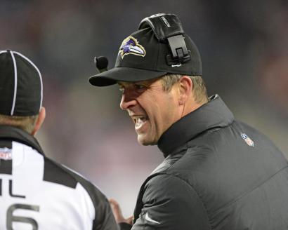 Ravens head coach John Harbaugh chats up head linesman Tony Veteri (Baltimore Ravens photo)