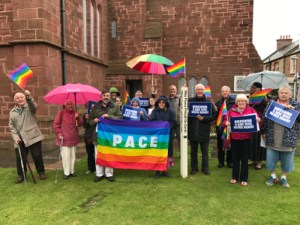 The Hiroshima vigil at St. Anne's Church, Dunbar, with an Italian Peace flag