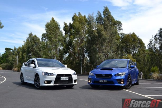 Subaru Impreza Wrx Sti Rally Car Wallpaper Head To Head Subaru Wrx Sti Vs Mitsubishi Lancer Evo X