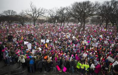 epa05739059 Thousands of participants converge on the Women's March on Washington in Washington, DC, USA, 21 January 2017. As many as a half million people are expected at the gathering, which organizers say is to 'promote women's equality and defend other marginalized groups', following the official inauguration on 20 January of Donald J. Trump as the 45th President of the United States.  EPA/JIM LO SCALZO