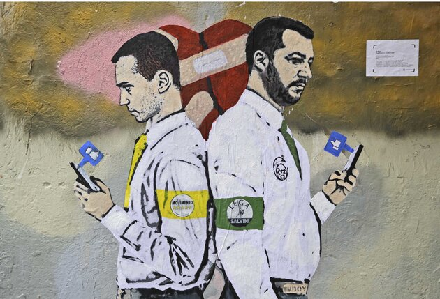 COMBO - This two-picture combo shows a mural of Italian Deputy Premiers 5-Star Movement's Luigi Di Maio, left, and The League's Matteo Salvini kissing on a wall in Rome, top, on March 23, 2018, and the populist government leaders with their backs to each other and their phones in their hands, in Milan, Italy, Thursday, Nov. 15, 2018. (AP Photo/Andrew Medichini, Luca Bruno)