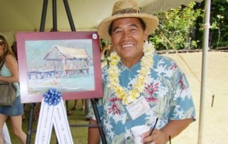 """Best of Show awardee Fred Tangalin with his winning picture, """"Hanalei Pier."""
