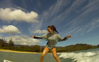 A young customer at Hanalei Surf School is seen here learning how to surf in Hanalei.