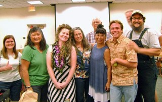 Margaret Schlass, owner of One Woman Farm, is greeted by Kaua'i's agriculture community members.